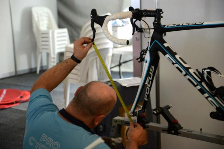 Daniel from Equipe cycliste AG2R LA MONDIALE making sure the Focus Bikes postion it set up back to the right spot after the long flight from Europe