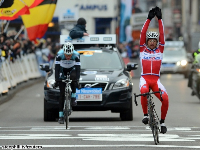 Katusha team rider Paolini of Italy celebrates as he wins the Omloop Het Nieuwsblad cycling race in Ghent