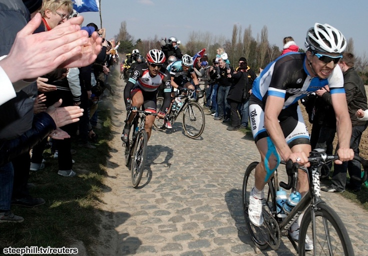 Vanmarcke of Belgium rides ahead of Cancellara of Switzerland as they cycle on a cobble-stoned section during the Paris-Roubaix cycling race from Compiegne to Roubaix