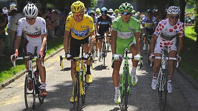 White jersey winner Tejay Van Garderen, yellow jersey winner Bradley Wiggins, green jersey winner Peter Sagan and polka dot jersey winner Thomas Voeckler.