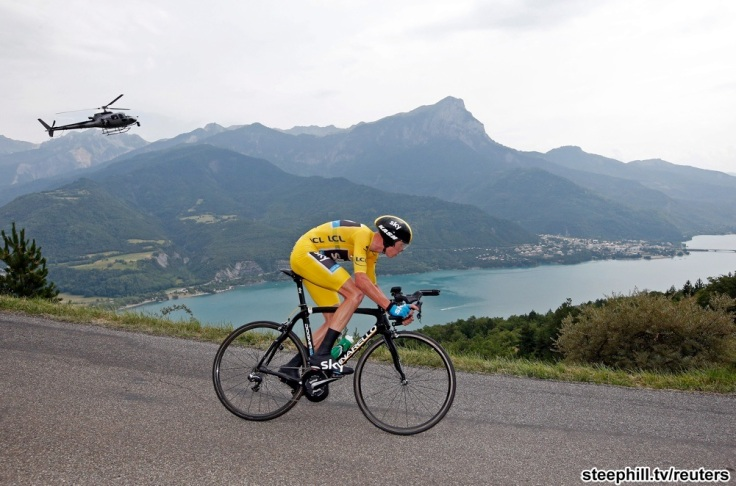 Race leader's yellow jersey holder Team Sky rider Christopher Froome of Britain cycles to win the 32km individual time-trial seventeenth stage of the centenary Tour de France cycling race from Embrun to Chorges