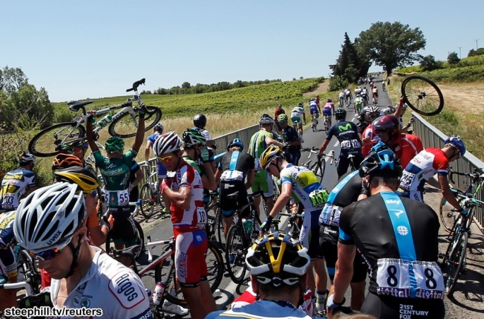 Riders fall during the 205.5 km seventh stage of the centenary Tour de France cycling race from Montpellier to Albi