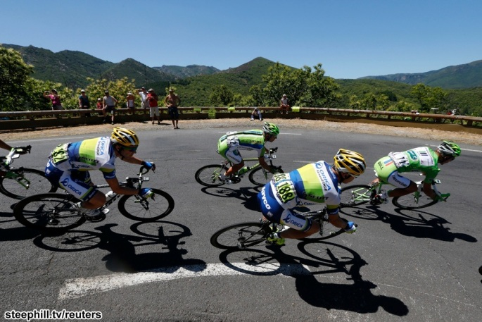 The pack of riders cycles on its way during the 205.5 km seventh stage of the centenary Tour de France cycling race from Montpellier to Albi