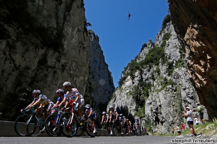 The pack of riders cycles on its way past the Gorges de Saint-Georges during the 195 km eight stage of the centenary Tour de France cycling race from Castres to Ax 3 Domaines