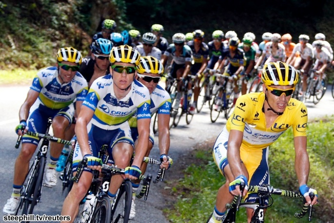 Orica Greenedge team rider Daryl Impey of South Africa leads the pack of riders during the 205.5 km seventh stage of the centenary Tour de France cycling race from Montpellier to Albi