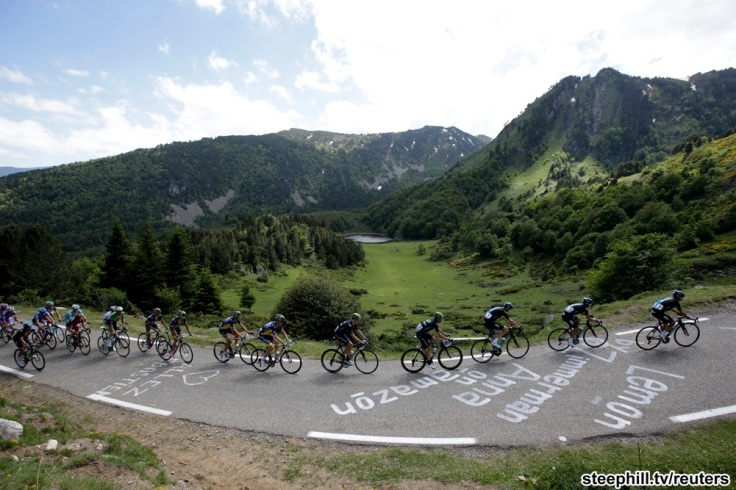 Team Sky riders lead the pack with Christopher Froome of Britain as they clim the Pailheres pass during the 195 km eight stage of the centenary Tour de France cycling race from Castres to Ax 3 Domaines