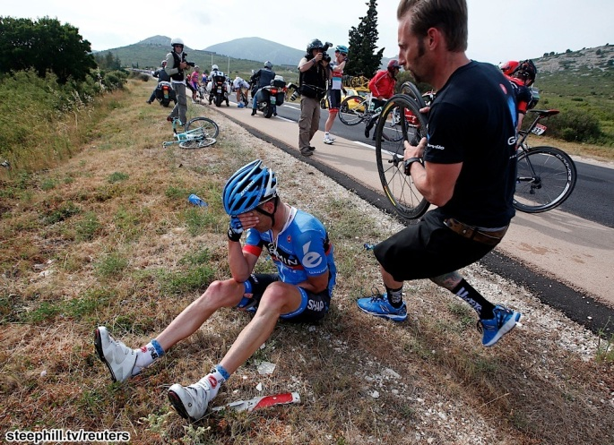 Garmin-Sharp team rider Christian Vandelde of th US falls during the 228.5 km fifth stage of the centenary Tour de France cycling race from Cagnes-Sur-Mer to Marseille