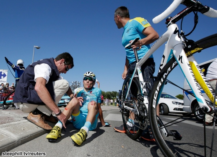 Astana team rider Janez Brajkovic of Slovakia receives medical care after he fell during the 176.5 km fifth stage of the centenary Tour de France cycling race from Aix-En-Provence to Montpellier