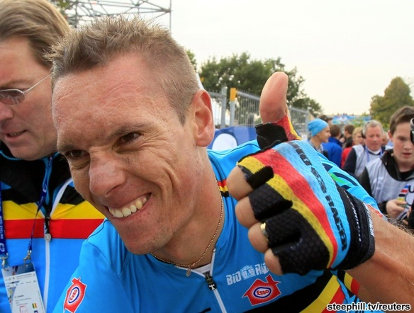 Philippe Gilbert of Belgium celebrates after winning the Men's Elite Road Race at the UCI Road World Championships in Valkenburg