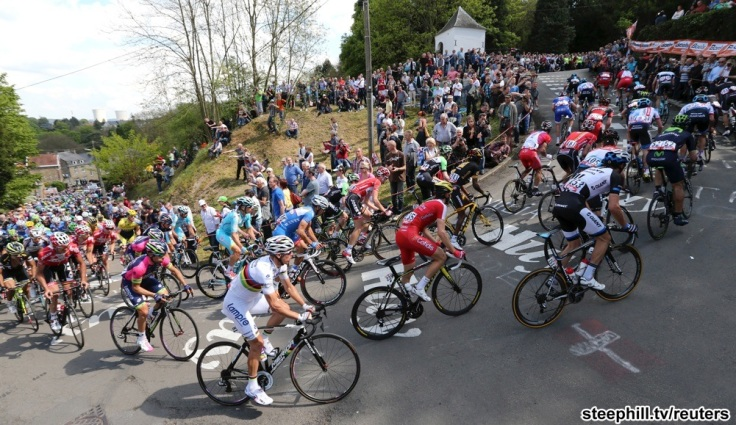 """A pack of riders climbs the """"Wall of Huy"""" during the Fleche Wallonne Classic cycling race in Huy"""