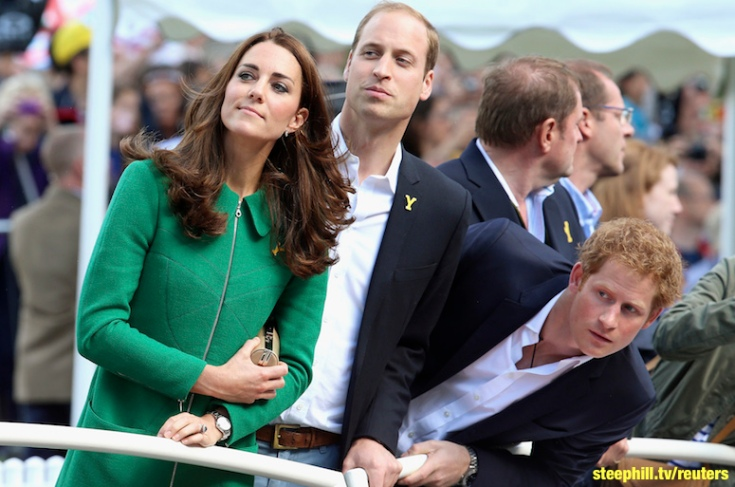 Catherine, Prince William and Prince Harry watch riders at the finish line of the first 190.5 km stage of the Tour de France cycling race from Leeds to Harrogate