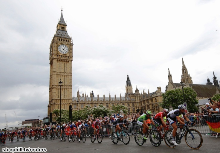 The pack of riders cycles on its way past the Big Ben clock tower and Houses of Parliament during the third stage of the Tour de France cycling race from Cambridge to London