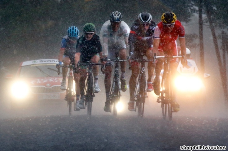 A group of breakaway riders pedal through a rain storm in the Pyrenees mountains during the 19th stage of theTour de France cycling race