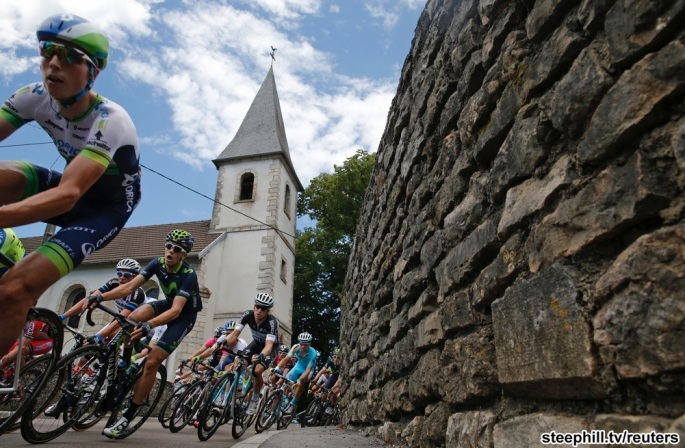 The pack of riders cycles on its way during the 187.5-km 11th stage of the Tour de France cycling race between Besancon and Oyonnax