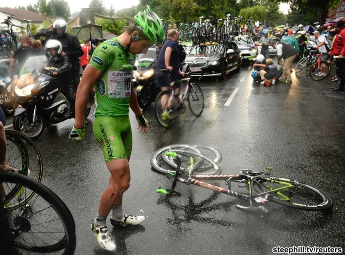 Cannondale team rider Sagan of Slovakia recovers after crashing during the 208.5km 19th stage of the Tour de France cycling race between Maubourguet and Bergerac