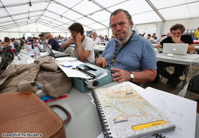 Italian journalist Mura poses after an interview with Reuters during the 124.5km seventeenth stage of the Tour de France cycle race between Saint-Gaudens and Saint-Lary Pla d'Adet