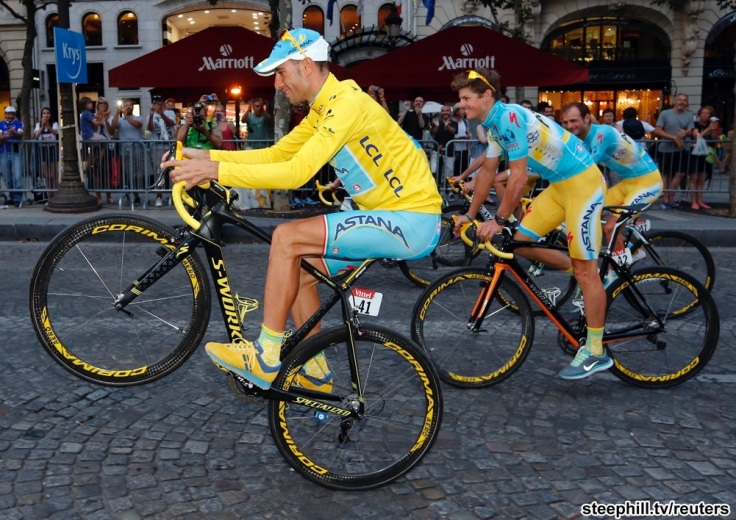 Astana team rider Nibali of Italy parades with team mates as he celebrates his overall victory after the 137.5 km final stage of the 2014 Tour de France, from Evry to Paris Champs Elysees