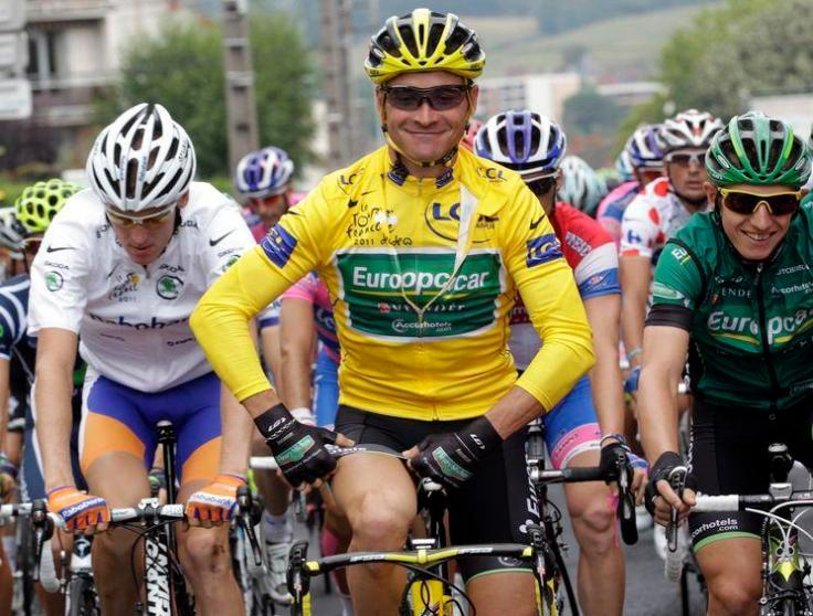 Europcar rider Thomas Voeckler of France, wearing the yellow jersey, rides during the tenth stage of the Tour de France 2011 cycling race from Aurillac to Carmaux July 12, 2011.   REUTERS/Denis Balibouse      (FRANCE - Tags: SPORT CYCLING)