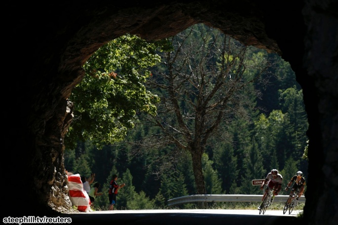 Riders enter a tunnel as they cycle during the 201-km (124 miles) 16th stage of the 102nd Tour de France cycling race from Bourg-de-Peage to Gap, France, July 20, 2015.   REUTERS/Benoit Tessier - RTX1L334