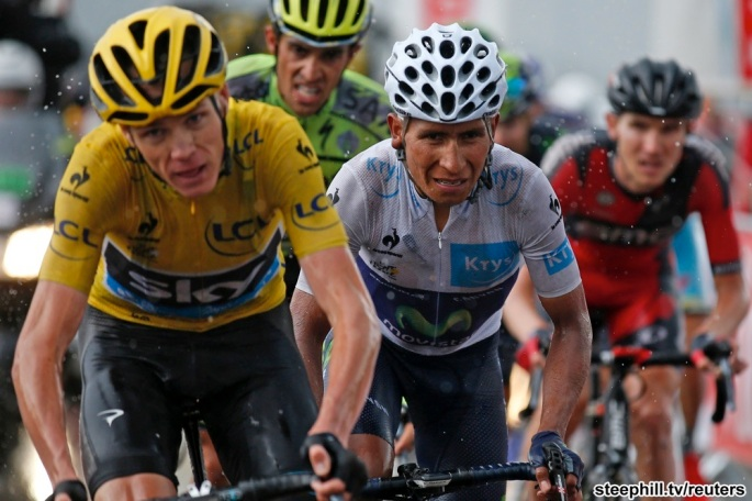 Team Sky rider Chris Froome of Britain (L), race leader's yellow jersey, and Movistar rider Nairo Quintana of Colombia (C) ride in the 195-km (121.16 miles) 12th stage of the 102nd Tour de France cycling race from Lannemezan to Plateau de Beille, in the French Pyrenees mountains, France, July 16, 2015. REUTERS/Benoit Tessier - RTX1KKB5