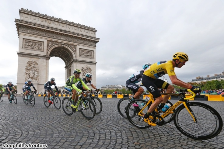 Team Sky rider Chris Froome of Britain (R), the race leader's yellow jersey, cycles near the Arc de Triomphe during the 109.5-km (68 miles) final 21st stage of the 102nd Tour de France cycling race from Sevres to Paris Champs-Elysees, France, July 26, 2015.   REUTERS/Pascal Rossignol - RTX1LVLP