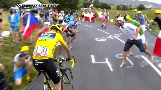 2ACF7DB600000578-3173629-A_fan_in_a_white_shirt_appears_to_spit_at_Chris_Froome_as_he_cyc-a-85_1437760788742
