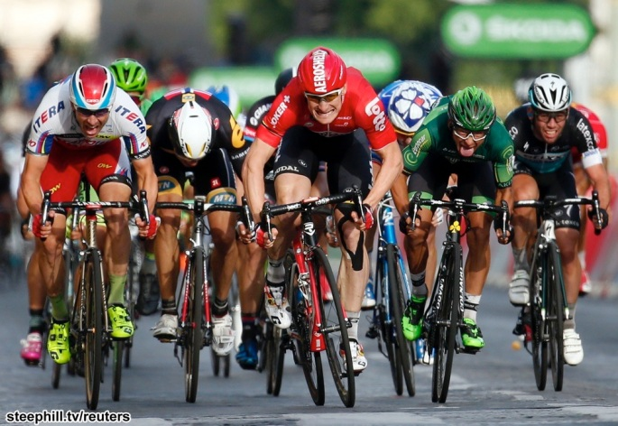 Lotto-Soudal rider Andre Greipel of Germany (C) sprints to cross the finish line to win the 109.5-km (68 miles) final 21st stage of the 102nd Tour de France cycling race from Sevres to Paris Champs-Elysees, France, July 26, 2015.        REUTERS/Benoit Tessier  TPX IMAGES OF THE DAY - RTX1LVUK