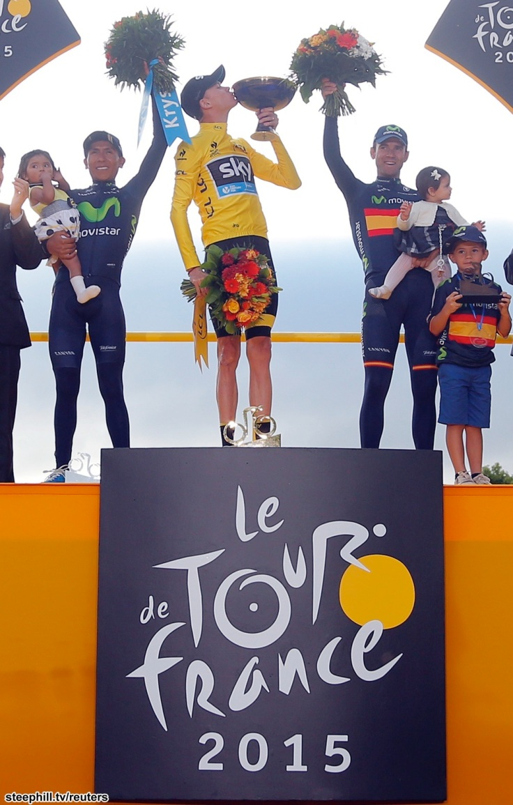 Team Sky rider Chris Froome of Britain (C), the race leader's yellow jersey, celebrates his overall victory on the podium with second placed Movistar rider Nairo Quintana of Colombia (L) and third placed Movistar rider Alejandro Valverde of Spain (R) after the 109.5-km (68 miles) final 21st stage of the 102nd Tour de France cycling race from Sevres to Paris Champs-Elysees, France, July 26, 2015.       REUTERS/Stephane Mahe - RTX1LVWE