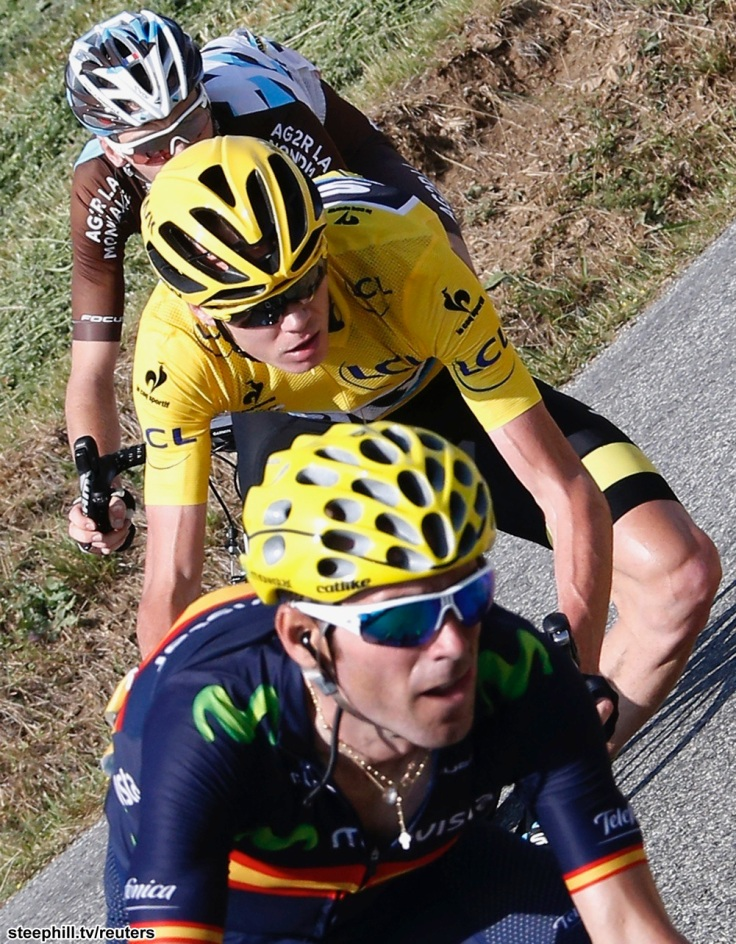 Movistar rider Alejandro Valverde of Spain (front) and Team Sky rider Chris Froome of Britain (C) cycle along the Manse pass during the 201-km (124 miles) 16th stage of the 102nd Tour de France cycling race from Bourg-de-Peage to Gap, France, July 20, 2015.    REUTERS/Eric Gaillard - RTX1L37B