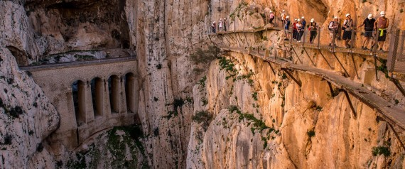MALAGA, SPAIN - APRIL 01: Tourists walk along the 'El Caminito del Rey' (King's Little Path) footpath on April 1, 2015 in Malaga, Spain. 'El Caminito del Rey', which was built in 1905 and winds through the Gaitanes Gorge, reopened last weekend after a safer footpath was installed above the original. The path, known as the most dangerous footpath in the world, was closed after two fatal accidents in 1999 and 2000. The restoration started in 2011 and reportedly cost 5.5 million euros. (Photo by David Ramos/Getty Images)