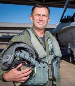 Executive Officer Test and Evaluation Directorate, Air Warfare Centre - Edinburgh, Wing Commander Jeff Frost in front of an F/A-18B Hornet at RAAF Base Williamtown.